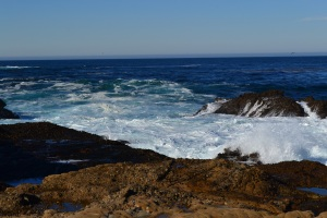 Waves splash against the rocks